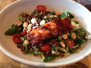 quinoa veggie salad with crunchy almonds, goat cheese, and grilled steelhead salmon